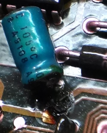 bad old capacitor 2 on board closeup